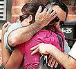 Joseph Randazzo hugs a family member outside his dad's home in Hillcrest, Queens, yesterday. Carmine Randazzo was fatally stabbed while strolling in the neighborhood.