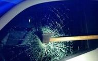 Ax from the attack stuck in the side window of MPD police car