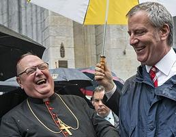 Archbishop of New York Cardinal Timothy Dolan, left, shares a light moment with New York Mayor Bill de Blasio during the annual Columbus Day Parade in New York